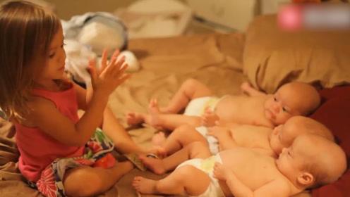 姐姐照顾三胞胎宝宝,挨个亲亲,真暖心呀!