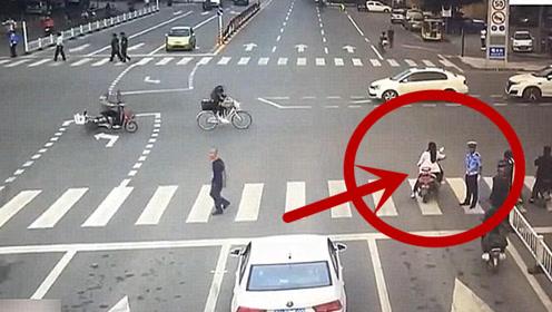 女子骑车不听交警劝导,嚣张闯红灯,悲剧画面被监控拍下