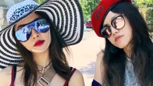 蔡依林与姐妹出国度假 穿荧光粉包臀裙曲线明显