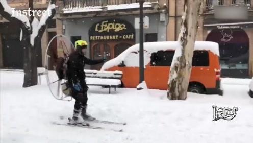 背着个超大号的电风扇,就能充当滑雪助推器