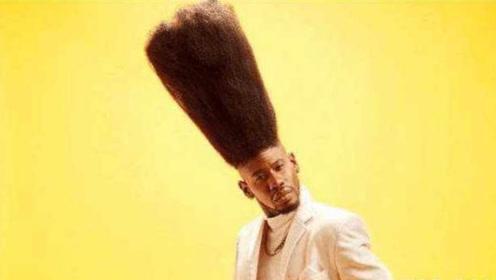 最烧钱吉尼斯纪录:小伙头发高52厘米,用10瓶啫喱水固定