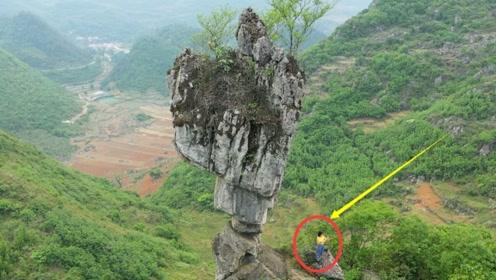 """云南深山现""""奇石"""",屹立悬崖千万年不倒,走近一看发现神奇画面"""
