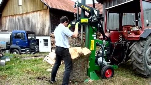 真是民间高手、用拖拉机改装一下变为劈柴神器