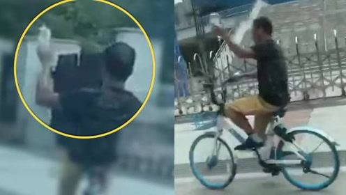 男子边举吊瓶输液边骑单车,网友:很心酸也很危险
