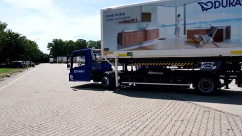 超低底盘货车,司机可以轻松进出,形似机场摆渡车