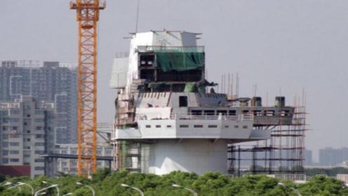 这座水泥航母楼又变样了!直通弹射甲板:第三艘航母外形已确定?