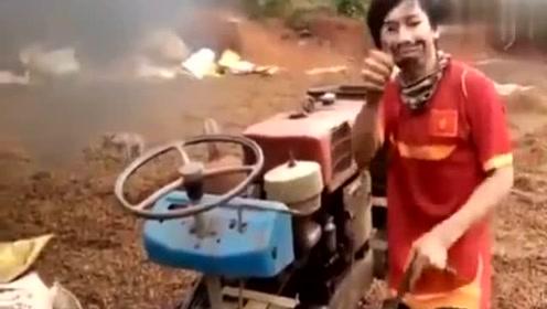 启动拖拉机最疯狂的人,头都在甩!