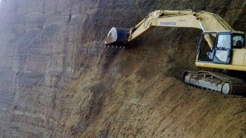 悬崖那么陡峭,挖掘机是如何爬上去作业的?