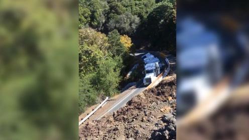 大卡车无视警告硬上狭窄山路 结果整个翻了下去