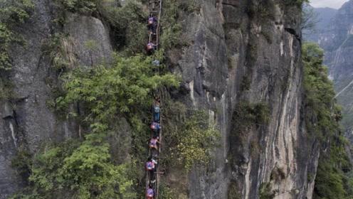 世界最牛村庄坐落在1400米悬崖上 当地村民出行成最大难题