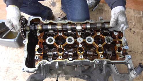分离发动机缸盖和机体,了解气门和活塞的结构原理
