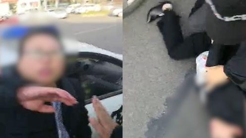 山西一女子违法拒不配合执法 被当场撂倒后口咬民警