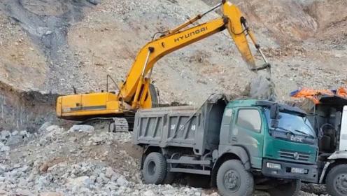 中国在悬崖边修路,挖掘机是如何被送上百米高空的?这方法太智慧