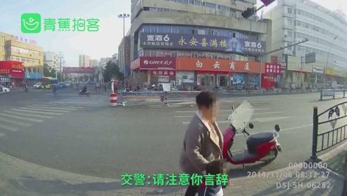 女子带娃骑车逆行被拦 怒怼交警:我家门口你管得了吗