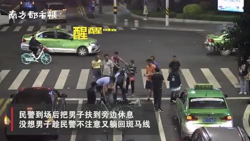 """广东珠海醉酒男子自带被子在路口""""打地铺"""",网友打趣:是讲究人"""