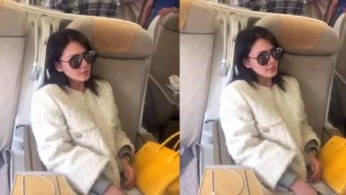 网友飞机上偶遇张雨绮,素颜戴墨镜憔悴不让拍,包包价值100多万