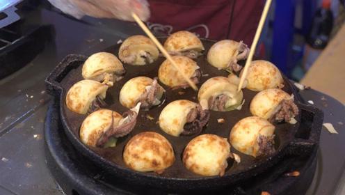 """越南独特""""章鱼小丸子"""",里面放一整块章鱼足,一口吃下太满足了"""