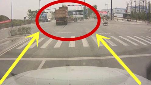 渣土车疾驰闯红灯,公交车与死神擦肩而过,监控拍下揪心一幕!