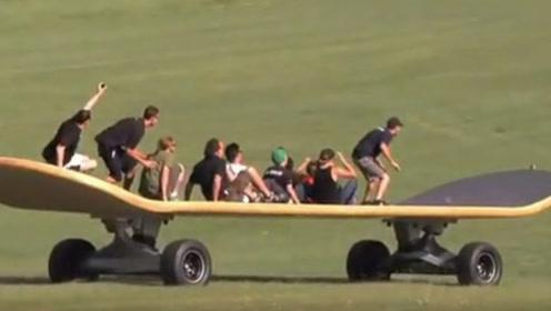 老外制造9米巨型滑板,搭载数十人一块玩,网友:看着就很刺激!
