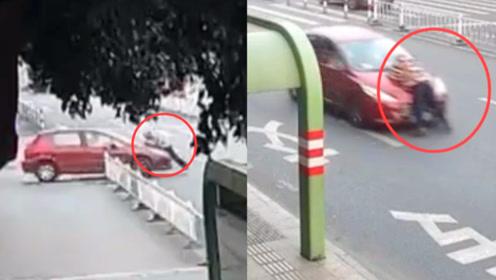 监拍:江苏一女司机开车顶行父亲街头急驰 父亲脚拖地被顶近1公里