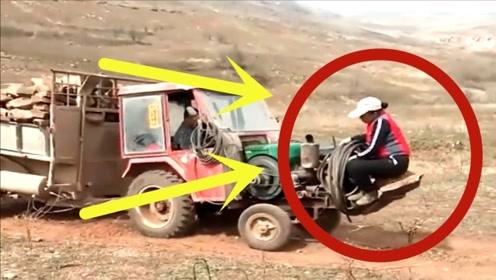 农村夫妇拉木材超重,上演神操作,拖拉机的这操作让我自愧不如!