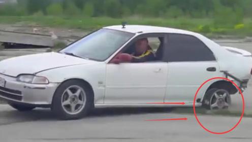 拉紧手刹汽车还能开动吗?国外大叔作死挑战,尴尬的一幕发生了