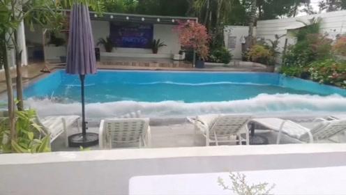 菲律宾发生地震 泳池水浪涌出人们纷纷下楼避难