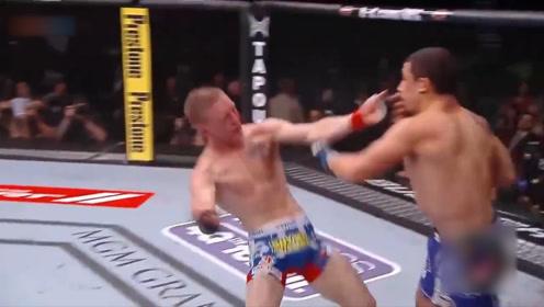 """他不愧是UFC擂台上的""""收割者"""", 对手攻击他自己却倒地!"""