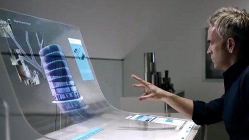 未来的电脑长这样,手可以抓屏幕中的物体,太奇幻