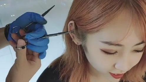 第一次见这样扎耳洞,直接拿针扎不疼吗?真是不敢相信