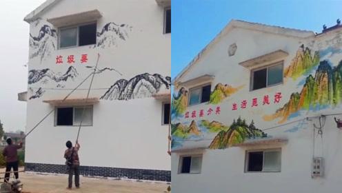 高手在民间:农村小伙偶遇画墙高手,用竹竿把乡村描成山水画