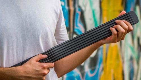 这个棍子居然是吉他,音质超群,小巧的可以放在包包里