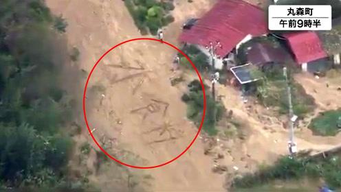 """日本台风受灾民众""""向天求助"""":地面用木头拼出""""水、食物""""大字"""
