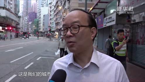 """""""我们很爱这个城市"""" 香港市民自发清理路障"""