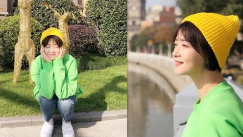 蒋欣小黄帽搭绿色上衣显青春 绿洲晒甜美自拍享受美好阳光