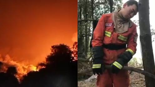 心疼!消防员佛山火场彻夜奋战 站着靠在树上睡着了还紧紧握着水带
