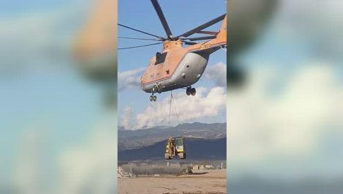 四川凉山最后无公路村修路,世界最大直升机运挖机助力