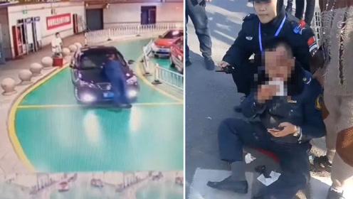 疯狂!执法人员查阻黑车遭暴力抗法 被顶行数米撞掉3颗牙齿