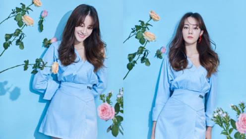 迪丽热巴身穿浅蓝色露肩连衣裙 人比花娇的美少女