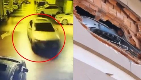 监拍青岛一超市停车场外墙被轿车撞穿 4辆车被砸另有3人受伤