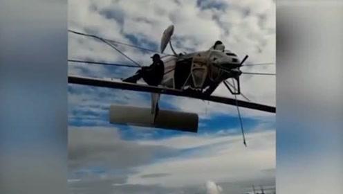 飞机突坠阿尔卑斯山 180度翻转倒挂电缆间