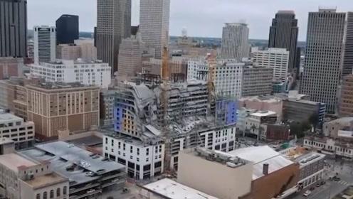 美国一18层在建酒店部分垮塌 事故瞬间街上路人狂奔躲避