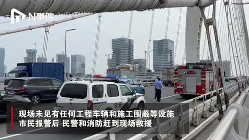 广州猎德大桥有一男子爬上吊索中上部,距桥面约50米,已被救下