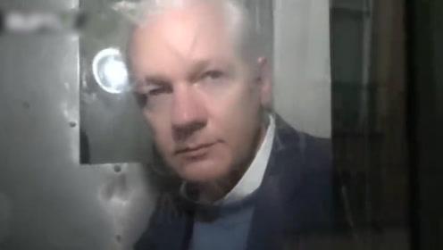 阿桑奇乘囚车前往听证会画面曝光:刮了长胡子 强忍泪水对话法官