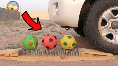 把足球放在钉床上,老外开车从上面压过,结果太解压了!