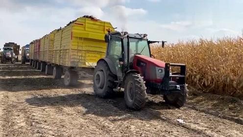 这拖拉机真强悍,拉几节满载的车厢