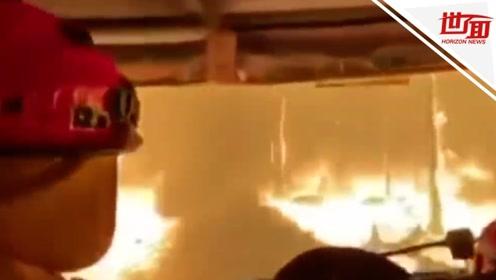 """澳山火肆虐致多人死亡 消防员在超百个着火点中""""穿越火线"""""""