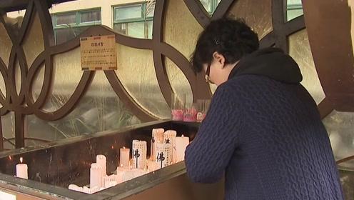 紧张!韩国高考临近 大批家长寺庙诵经祈福