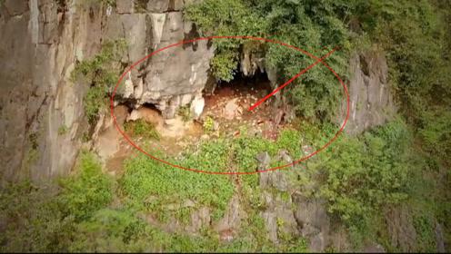 """实拍悬崖洞穴,里面是一个大型墓地,地上散落着很多""""钱"""""""