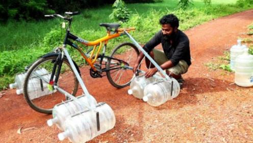 水桶能否将人浮起来?老外用自行车冒险一试,结果让人意外!